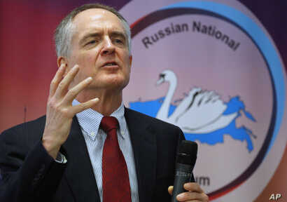 """FILE - U.S. writer Jared Taylor speaks during the International Russian Conservative Forum in St.Petersburg, Russia, March 22, 2015. Taylor, a Yale University-educated, self-described """"race realist, """" runs the New Century Foundation."""