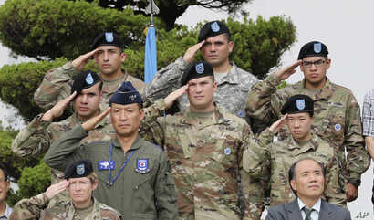 FILE - U.S. and South Korean soldiers salute during a change of command and change of responsibility ceremony for Deputy Commander of the South Korea-U.S. Combined Force Command at Yongsan Garrison, a U.S. military base, in Seoul, South Korea.