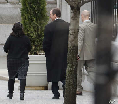 House Intelligence Committee ranking member Rep. Adam Schiff, D-Calif. (center) leaves the White House complex in Washington, March 31, 2017.