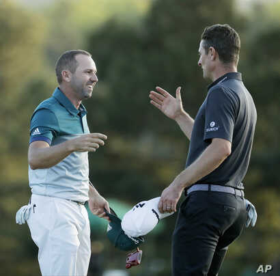 Sergio Garcia, left, shakes hands with Justin Rose, after making his birdie putt on the 18th green to win the Masters.