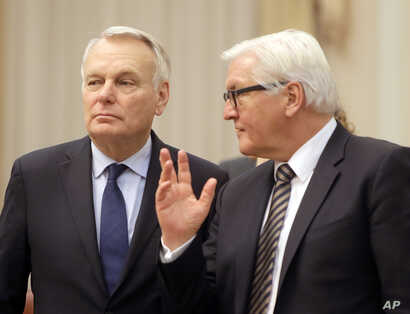 German Foreign Minister Frank-Walter Steinmeier, right, and French Foreign Minister Jean-Marc Ayrault talk ahead of their meeting with Ukrainian officials in Kiev, Feb. 22, 2016. Germany and France are pushing for Ukraine to move ahead with reforms n...