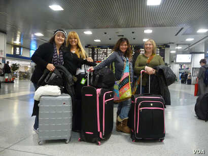 Preparing to board their train home, out-of-towners Sandy (second from right) and her friends are grateful they survived their unexpected adventures in New York. (VOA/A. Phillips)
