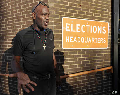 Former felon Robert Eckford talks with reporters after registering to vote at the Supervisor of Elections office Tuesday, Jan. 8, 2019, in Orlando, Fla.