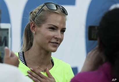 Russia's long jumper Darya Klishina speaks at the National track and field championships at a stadium in Cheboksary, Russia, Monday, June 20, 2016.