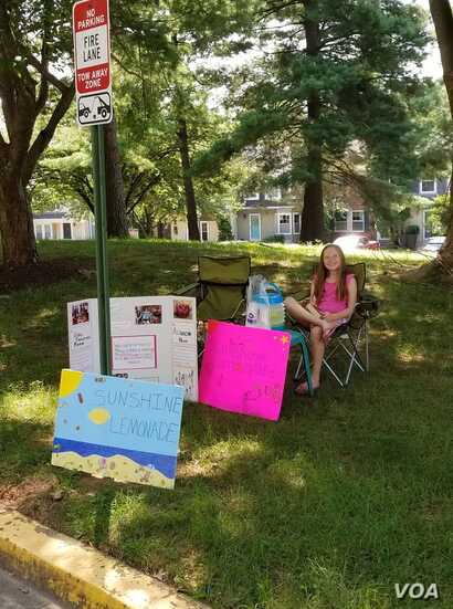 Nine-year-old Maya Forbes raised $25 from her lemonade stand in Germantown, MD, Aug. 11, 2018. Mayan and her mother also raised money through yard sales and benefit workouts. They hope to bring the donations back to Bangladesh in November.