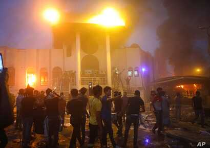 Protesters storm and burn the Iranian consulate building in Basra, 340 miles (550 km) southeast of Baghdad, Iraq, Sept. 7, 2018.