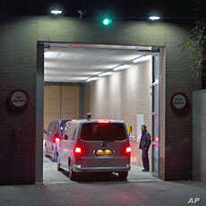A motorcade of two cars believed to be carrying Ivory Coast's former president Laurent Gbagbo enters the prison in Scheveningen, November 30, 2011