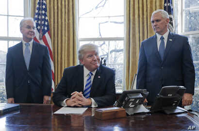 President Donald Trump, flanked by Health and Human Services Secretary Tom Price (left) and Vice President Mike Pence, told  members of the media Friday that with the collapse of the health care overhaul bill, he would turn his attention to tax refo...