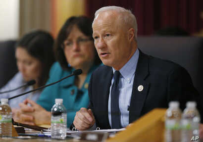 U.S. Rep. Mike Coffman, R-Colo. (front), makes a point while Rep. Ann Kuster, D-N.H., looks on during a House Veterans Affairs subcommittee field hearing, May 20, 2016, in the State Capitol in Denver.