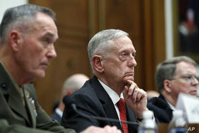 Joint Chiefs Chairman Gen. Joseph Dunford, left, Defense Secretary Jim Mattis, and Defense Under Secretary and Chief Financial Office David Norquist, listen to a question as they testify at a House Armed Services Committee hearing on the FY'18 defens