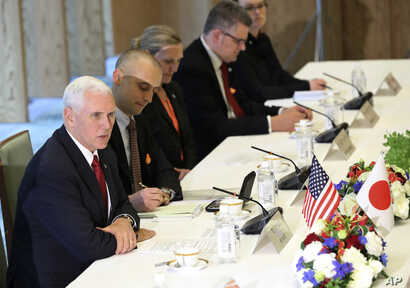 US Vice President Mike Pence, left, speaks with Japanese Deputy Prime Minister and Finance Minister Taro Aso, not in picture, during the Japan-U.S. Economic Dialogue at the prime minister's office in Tokyo, April 18, 2017.