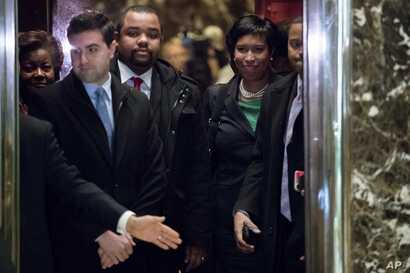 Washington Mayor Muriel Bowser, right, boards an elevator at Trump Tower in New York, Dec. 6, 2016.