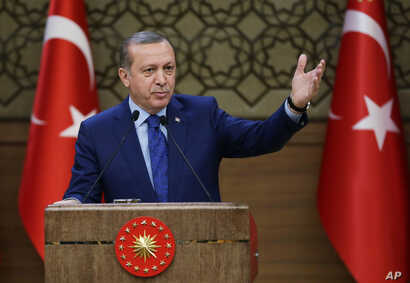 Turkish President Recep Tayyip Erdogan addresses a meeting of local administrators at his palace in Ankara, March 16, 2016.
