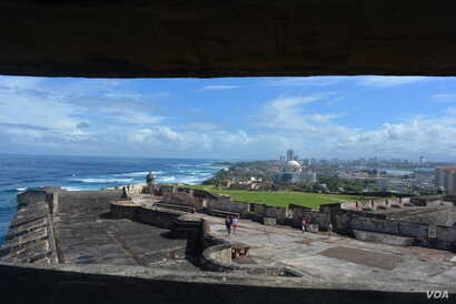 The massive Castillo San Felipe del Morro fort, built in the 1500s, was designed to defend the Spanish colonial port city of San Juan from seaborne enemies. Today, it overlooks modern San Juan.