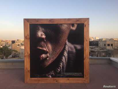 """A photograph of a former child beggar displayed at the """"Look at me"""" exhibition, Dakar, Senegal, May 3, 2018."""