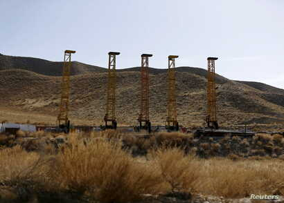 FILE - Equipment and machines are seen near a copper mine in Mes Aynak, Logar province, Feb. 14, 2015.
