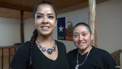 Desaree Reyes and her wife Marcella. (G. Flakus/VOA)
