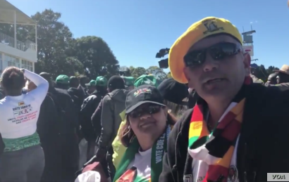 """Some of the Zimbabweans following proceedings at the Zanu PF's """"white interface rally,"""" July 21, 2018, in Harare where President Emmerson Mnangagwa was speaking."""
