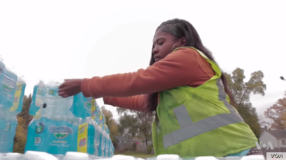 Free bottled water is available for residents of Flint, Michigan.