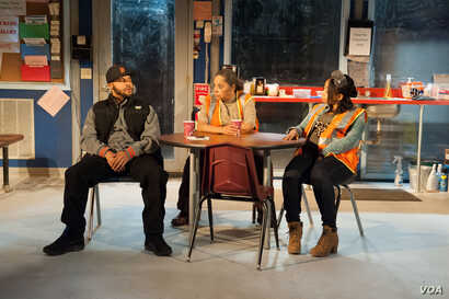 Jason Dirden as Dez, Lynda Gravatt as Faye, Nikiya Mathis as Shanita in a scene from Skeleton Crew