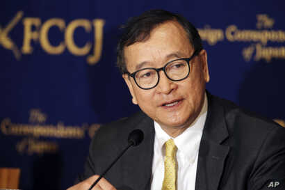 In this April 13, 2018, photo, Cambodia's self-exiled opposition leader Sam Rainsy speaks during a press conference in Tokyo.