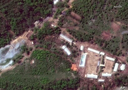 FILE - This Wednesday, May 23, 2018 satellite file image provided by DigitalGlobe, shows the Punggye-ri test site in North Korea.