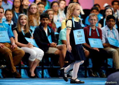 Edith Fuller, 6, of Tulsa, Oklahoma, takes the stage during the 2017 Scripps National Spelling Bee at National Harbor in Oxon Hill, Md., May 31, 2017.  Edith is the youngest speller at the 90th national bee.