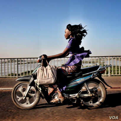 Jane Hahn: Riding over the Niger River  in Bamako, Mali.