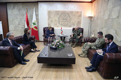 In this photo released by the Lebanese army official website, Lebanese Army Commander Gen. Joseph Aoun, center right, meets with U.S. Undersecretary of the Air Force for International Affairs Heidi Grant and U.S. Ambassador to Lebanon Elizabeth Richa...