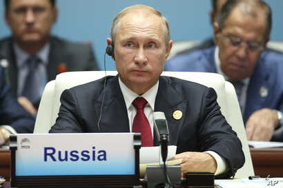 Russian President Vladimir Putin attends  the Dialogue of Emerging Market and Developing Countries on the sideline of the BRICS Summit in Xiamen, China, Sept. 5, 2017.