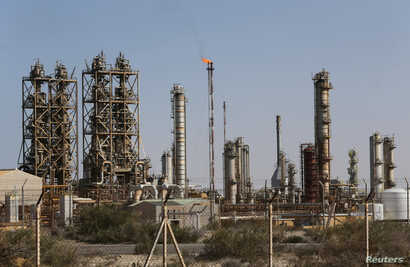 FILE -- Pipelines are seen at the industrial zone at the oil port of Brega, Libya, Jan. 12, 2017.