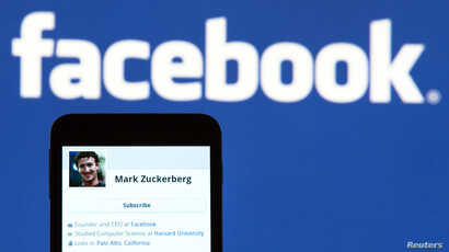 FILE - The Facebook profile of founder Mark Zuckerberg on a mobile phone is seen in this photo illustration.