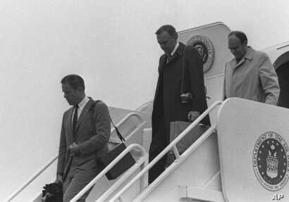 President Nixon's White House Chief of Staff H.R. Haldeman, left, and presidential adviser John D. Ehrlichman, right, deplane Air Force One at Andrews Air Force Base in Md. in this April 1973  file photo.
