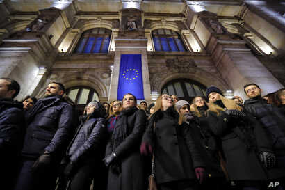 Romanian magistrates stand during a silent protest outside the Bucharest Court of Appeal in Bucharest, Romania, Dec. 18, 2017.