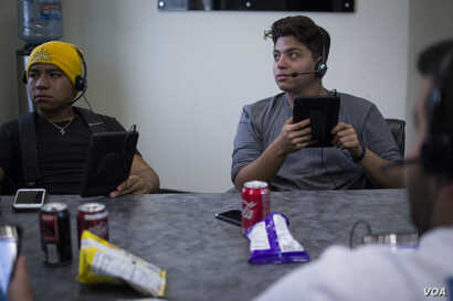 17-year-old Wilfredo Villeda, right, volunteers with The Libre Initiative, making phone calls in support of dreamers like himself.