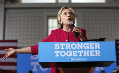 FILE - A recent Associated Press investigation said more than half the people outside the government who met with Hillary Clinton — pictured above during a presidential campaign stop in Philadelphia in August 2016 — while she was secretary of sta...
