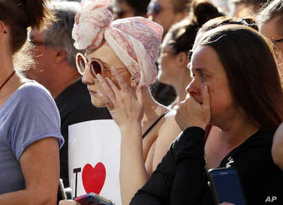 People attend a vigil in Albert Square, Manchester, England, May 23, 2017, the day after the suicide attack at an Ariana Grande concert that left 22 people dead as it ended on Monday night.
