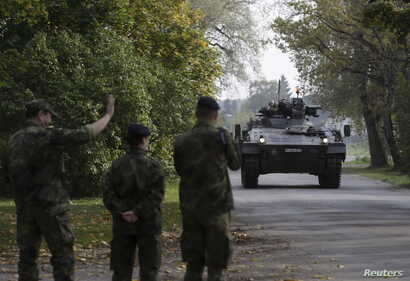 FILE - German army soldiers arrive for a NATO military drill Oct. 4, 2015, in Adazi, Latvia. With signs growing of a thaw between Moscow and Western capitals, some of Russia's neighbors fear a dip in  European resolve over the Ukraine crisis.