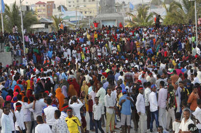 Protesters march near the scene of Saturday's massive truck bomb attack in Mogadishu, Somalia, Oct. 18, 2017.