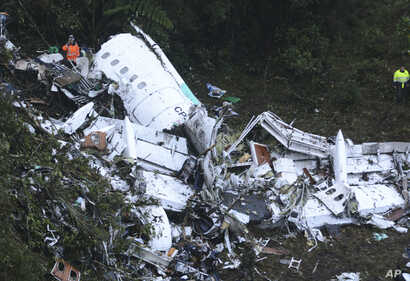 Rescue workers at the wreckage of an airplane that was carrying the Brazilian soccer club Chapecoense when it crashed outside Medellin, Colombia, Nov. 29, 2016.