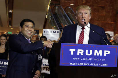 Republican presidential candidate Donald Trump, right, introduces Setya Novanto, speaker of the House of Representatives of Indonesia, during after a news conference at Trump Tower in New York, Sept. 3, 2015.