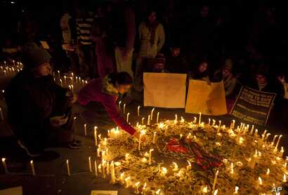 Indians light candles as they mourn the death of a gang rape victim in New Delhi, India, Dec. 30, 2012.