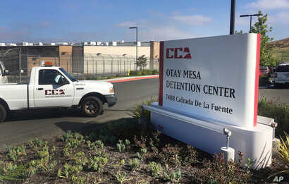 FILE - In this June 9, 2017, file photo, a vehicle drives into the Otay Mesa detention center in San Diego, Calif.