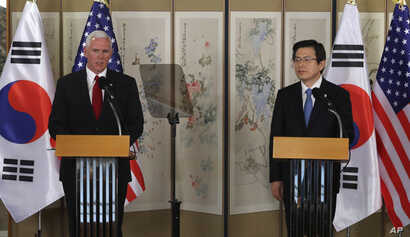 U.S. Vice President Mike Pence, left, speaks as South Korea's acting President and Prime Minister Hwang Kyo-ahn listens during a joint news conference after their meeting in Seoul, South Korea, Monday, April 17, 2017.