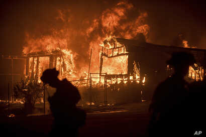 Flames from a wildfire consume a residence near Oroville, California, July 9, 2017. Evening winds drove the fire through several neighborhoods leveling homes in its path.