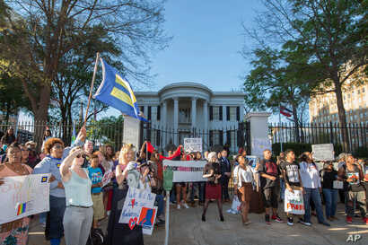 A crowd of around 500 people protested a bill permittin service denial to gays outside the governor's office during a rally by the Human Rights Campaign in Jackson, Mississippi, April 4, 2016.