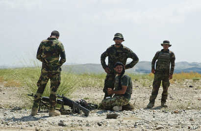 FILE - Afghanistan's National Army soldiers take positions in Khogyani district, in Nangarhar province, east of Kabul, Afghanistan.