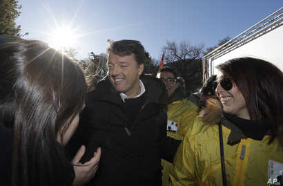 Former Italian Premier Matteo Renzi attends a demonstration staged by the Democratic party, in Como, Italy, Saturday, Dec. 9, 2017.