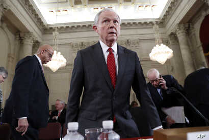 FILE - Attorney General-designate Sen. Jeff Sessions takes his seat on Capitol Hill in Washington, Jan. 10, 2017, after a break in his confirmation hearing before the Senate Judiciary Committee.