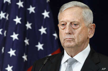 Defense Secretary James Mattis attends a news conference, Aug. 17, 2017, at the State Department in Washington.
